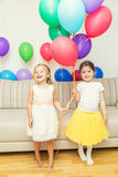 Two girls at birthday party Stock Photography