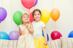 Two girls at birthday party Stock Photos