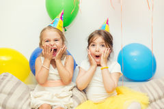 Two girls at birthday party Stock Photo