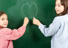 Two girls with blackboard Stock Photo