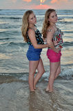 Two girls blonde on the beach at sunset Royalty Free Stock Image