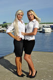 Two Girls Blonde Stand On The Pier Stock Photo