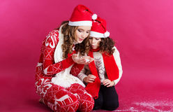 Two girls are blowing fake snow Stock Photo