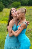 Two girls in blue dress Stock Photography