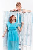 Two girls in blue dresses Stock Photo