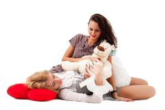 Two girls with book and toys Royalty Free Stock Photos