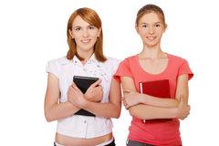 Two girls with books Stock Images