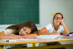 Two girls are bored in classroom Stock Image