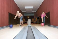 Two Girls Bowling Royalty Free Stock Photo