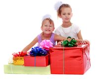 Two girls with boxes for gifts Royalty Free Stock Photography