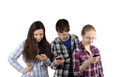 Two girls and boy with cell phones Stock Photo