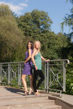 Two girls on the bridge Royalty Free Stock Photography