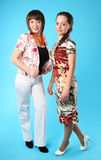 Two girls in bright clothes Stock Photo