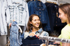 Two girls buying vest in a store Stock Image