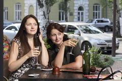 Two girls in a cafe Stock Images