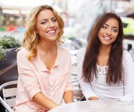 Two girls in a cafe Royalty Free Stock Photography