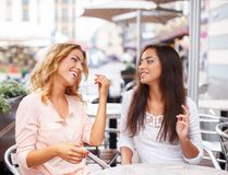 Two girls in a cafe Royalty Free Stock Photos