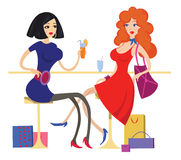 Two girls in the cafe. Two girls drinking cocktails and talking in the cafe Stock Images