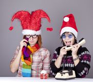 Two girls calling to Santa Royalty Free Stock Image