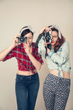 Two girls. With cameras in retro style royalty free stock photo
