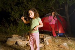 Two girls at a camp. Eating marshmallow Royalty Free Stock Photo