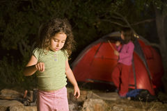 Two girls at a camp site Stock Photo
