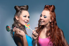 Two girls with candy Royalty Free Stock Images