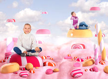 Two girls in a Candy land. Bonbons Royalty Free Stock Image