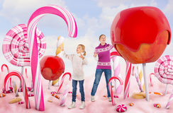 Two girls in a Candy land. Two girls in a beautiful Candy land Royalty Free Stock Photo