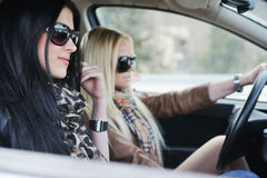 Two girls in a car Royalty Free Stock Image