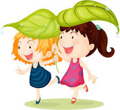 Two Girls Carrying Leaves on Head Stock Photo