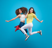 Two girls caught in jump Royalty Free Stock Photos