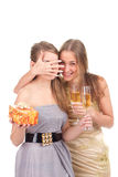 Two girls celebrate Christmas. With gifts and glasses in their hands studio shooting Royalty Free Stock Image