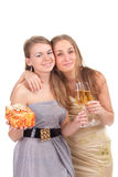 Two girls celebrate Christmas. With gifts and glasses in their hands studio shooting Stock Image