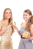 Two girls celebrate Christmas. With gifts and glasses in their hands studio shooting Stock Photo