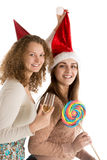 Two girls celebrate christmas or new year Stock Photos
