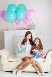 Two girls are celebrating birthday Royalty Free Stock Image