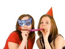 Two girls celebrating new year Stock Image