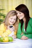 Two girls with a cellphone Royalty Free Stock Photo