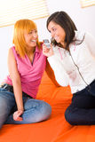 Two girls with cellphone Royalty Free Stock Photos