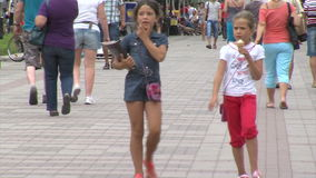 Two girls in the center of Pomorie in Bulgaria stock footage