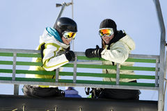 Two girls on chairlift Stock Photography