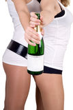 Two girls with a champagne bottle Royalty Free Stock Photos