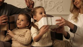 Two girls checking what presents they`ve got for Christmas. royalty free stock image