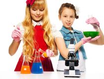 Two girls and chemistry Royalty Free Stock Photography