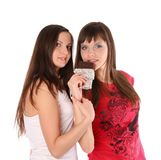 Two girls with chocolate Stock Images