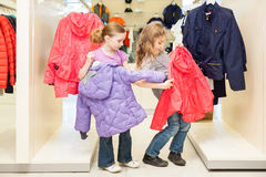 Two girls choose clothes in a store Royalty Free Stock Images