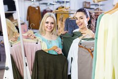 Two girls choosing clothes Royalty Free Stock Photography