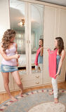 Two girls choosing dress Royalty Free Stock Image