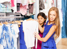 Two girls choosing the right item during shopping Royalty Free Stock Photography